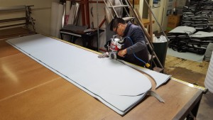 Cutting longboard bag panels.